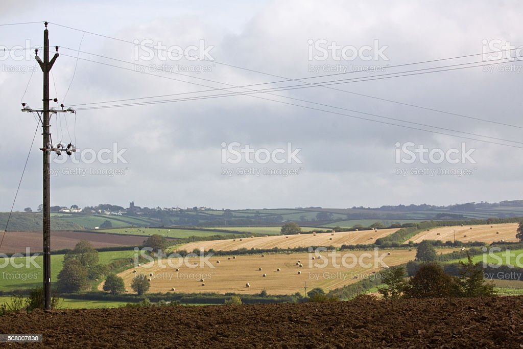 Landscape with power lines in Devon UK stock photo