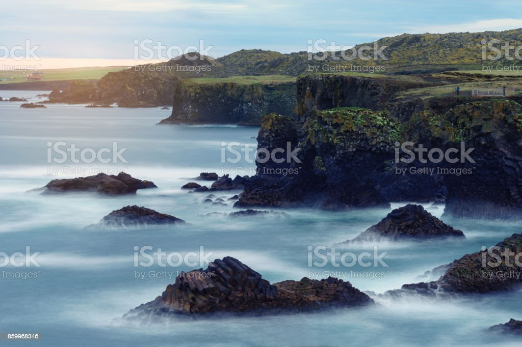 Landscape with rocky cliffs on seashore. stock photo