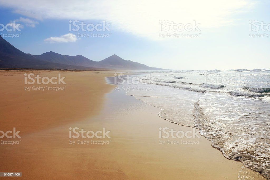 Landscape with sandy beach, the sea and the mountains. stock photo