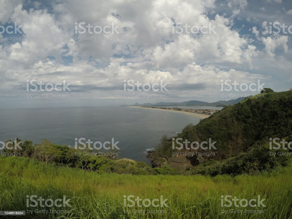 Landscape with sea, beach and cloudy sky stock photo