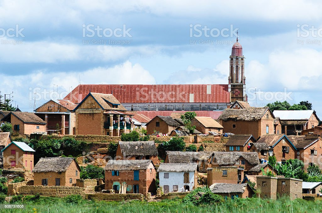 Landscape with square houses, church and dramatic sky in Madagascar - Photo