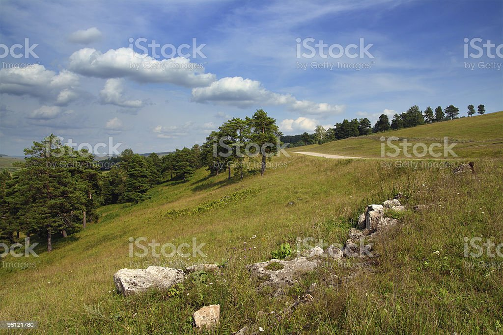 landscape with stones and road on hill royalty-free stock photo