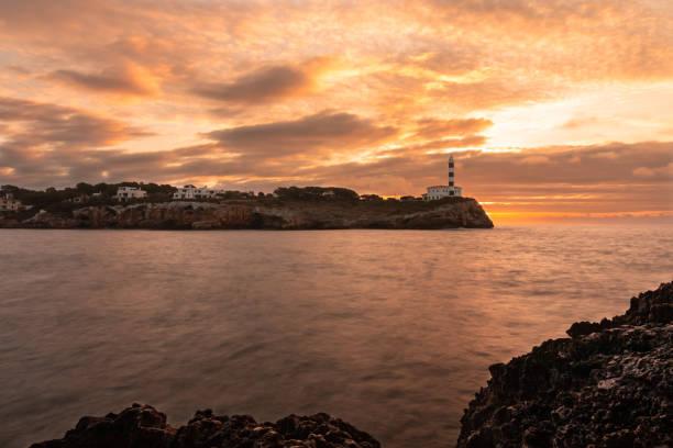 Landscape with the Portocolom lighthouse in Majorca, at sunrise stock photo