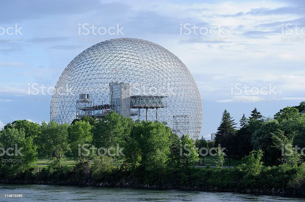 Landscape with trees and river with geodetic dome in back stock photo