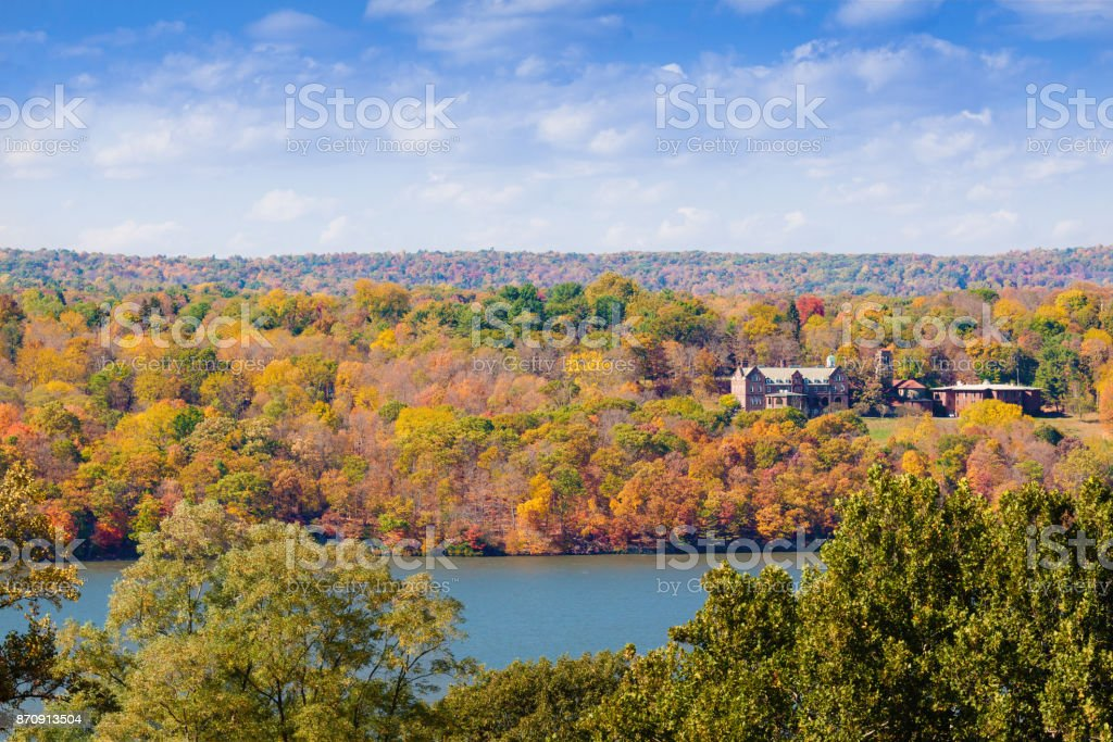 Landscape with Trees in Autumn Colors (Foliage), Holy Cross Monastery and Hudson River, Hudson Valley, New York. stock photo