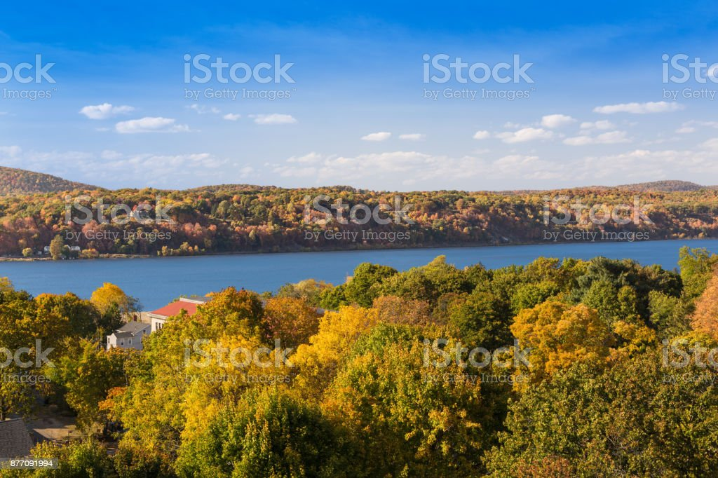 Landscape with Trees in Autumn Colors (Foliage), Hudson River and Blue Sky, Poughkeepsie, Hudson Valley, New York. stock photo