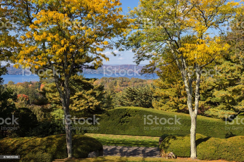 Landscape with Trees in Autumn Colors (Foliage), Hudson River and Blue Sky, Westchester County, Hudson Valley, New York. stock photo