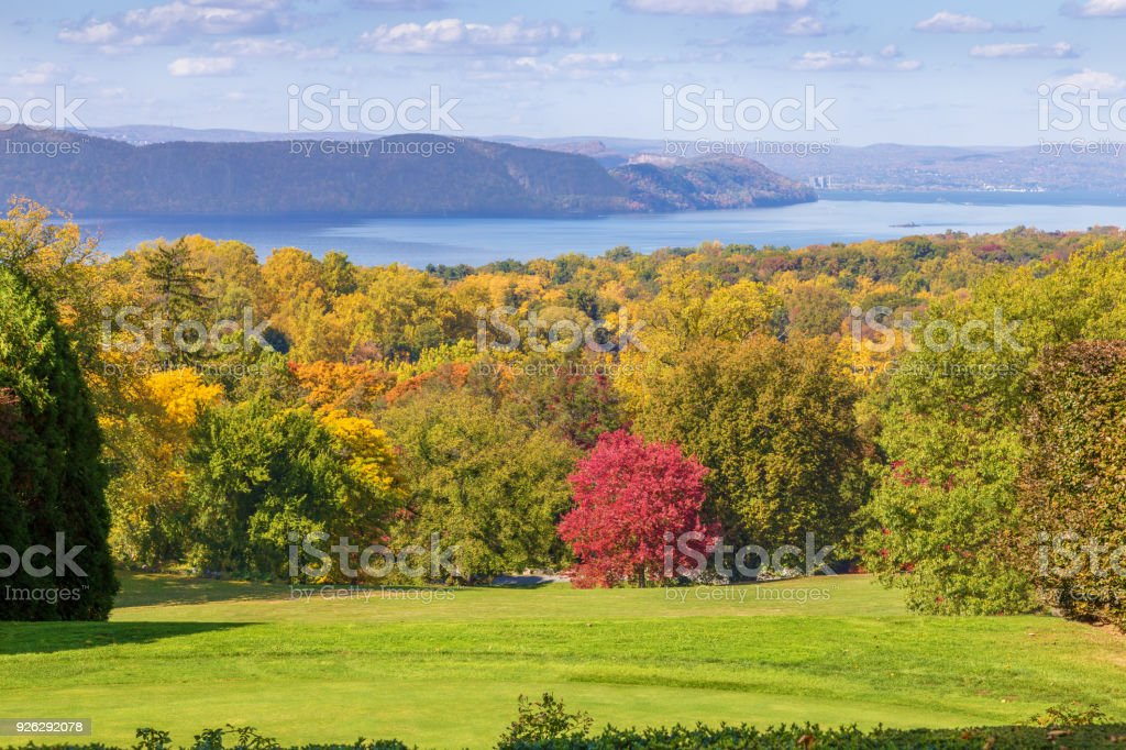 Landscape with Trees in Autumn Colors (Foliage), Hudson River and Vivid Blue Sky, Hudson Valley, New York. stock photo