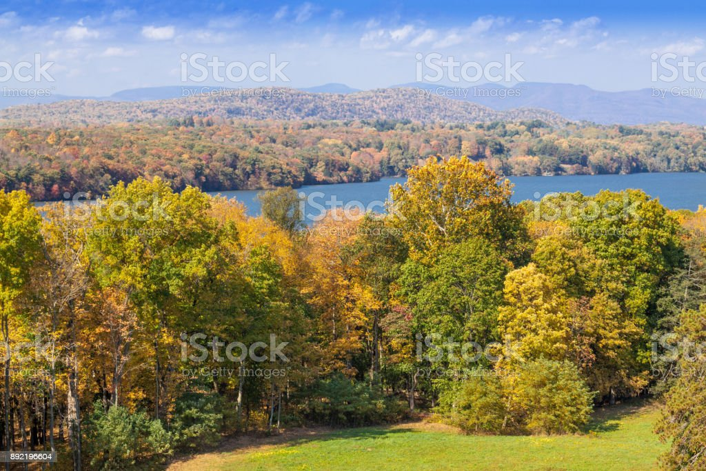 Landscape with Trees in Autumn Colors (Foliage), Hudson River, Catskill Mountains and Blue Sky, Westchester County, Hudson Valley, New York. stock photo