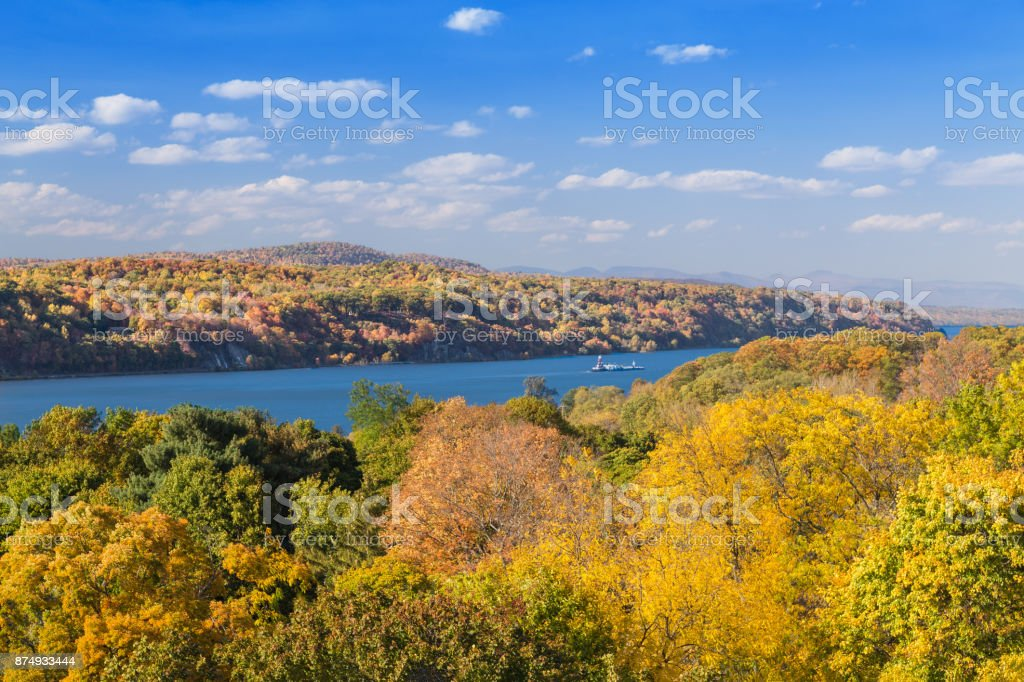 Landscape with Trees in Autumn Colors (Foliage), Hudson River, Tugboat and Catskill Mountains, Poughkeepsie, Hudson Valley, New York. stock photo
