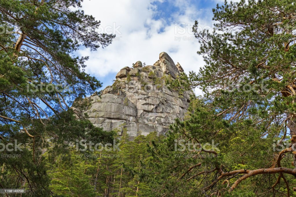 Landscape with weathered granite outcrops and trees. Burabay National...