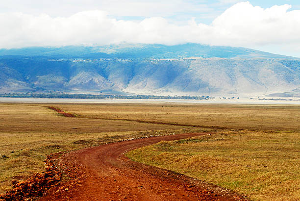 Landscape with winding road,  Ngorongoro Crater in Tanzania stock photo