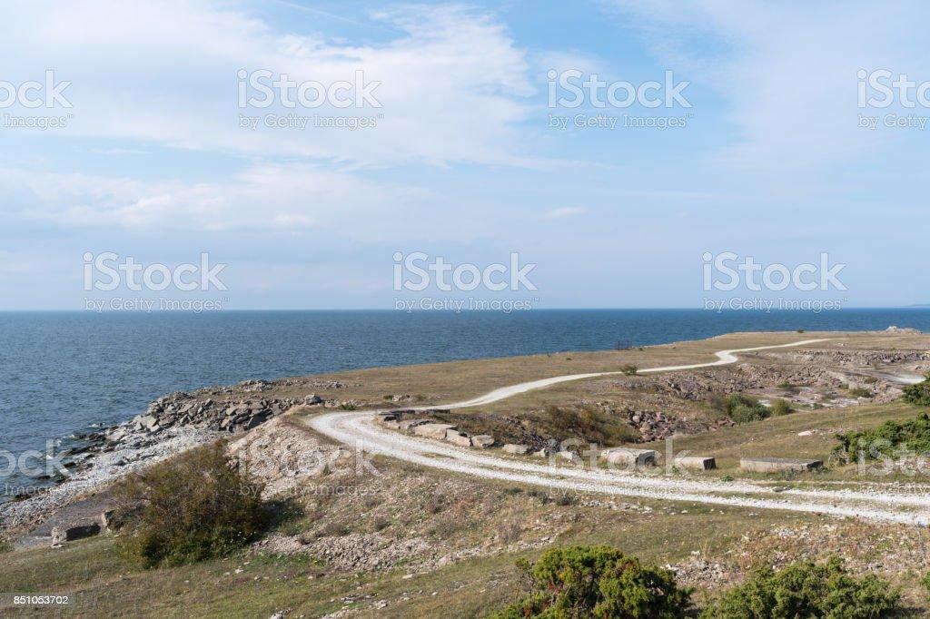 Landscape witha gravel road along the coast stock photo