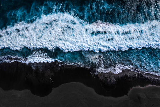 Landscape_Indian Ocean - Reunion Drone shot of the Indian Ocean, La Réunion black sand stock pictures, royalty-free photos & images