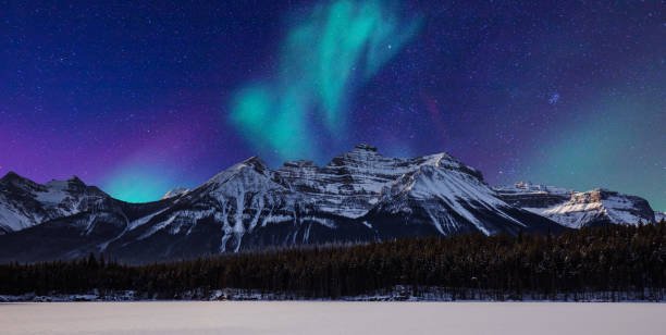 landscape-aurora and mountain - banff national park stock photos and pictures