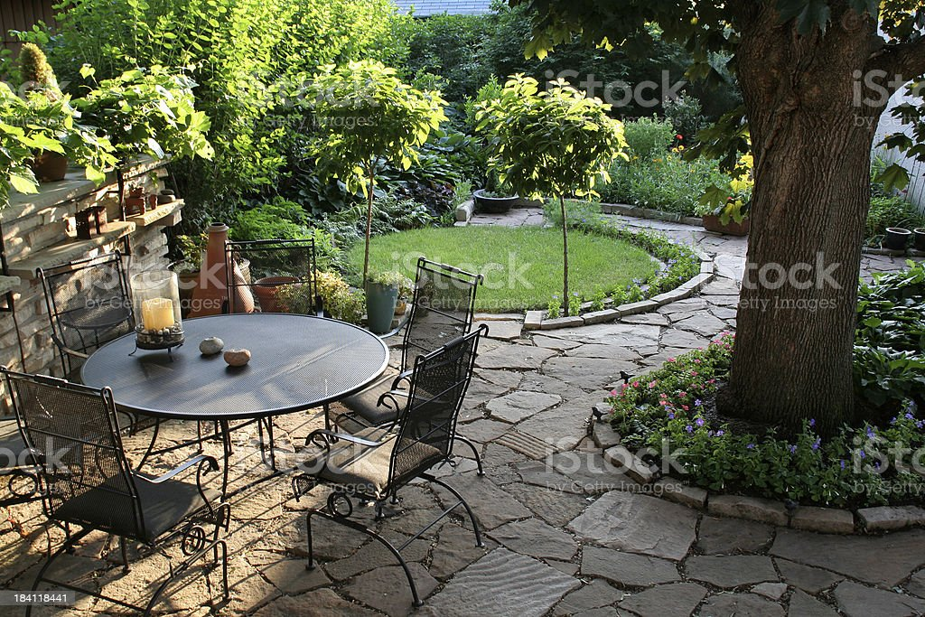 Landscaped Back Yard Patio, Flower Garden with Natural Paving Stones stock photo