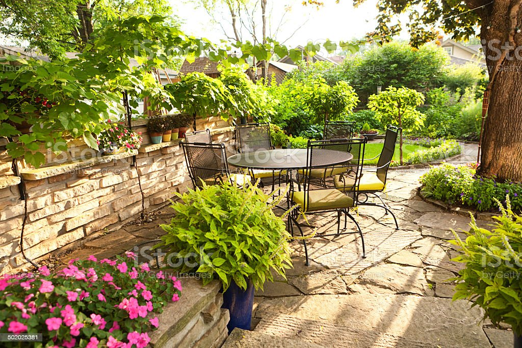 Landscaped Back Yard Patio Garden with Potted Plants, Furniture, Flowers stock photo