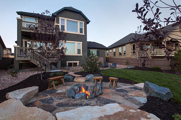 Landscaped backyard with beautiful Fire pit stock photo