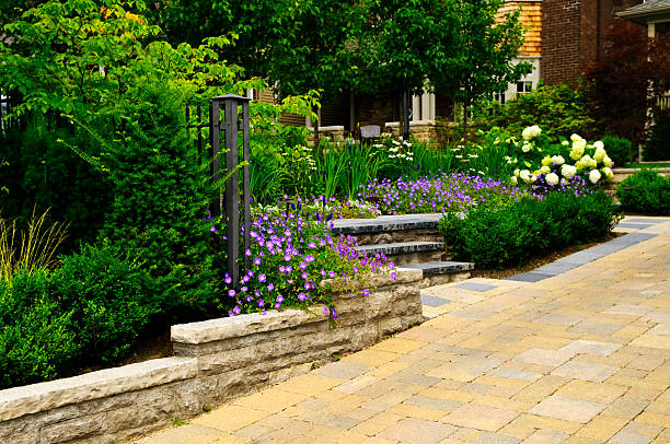 Landscaped  garden and stone paved driveway stock photo