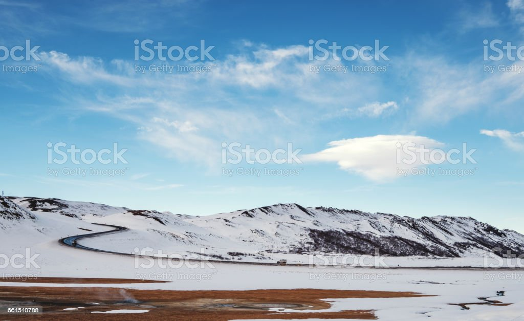 Landscaped in winter with country road and lenticular cloud on blue sky royalty-free stock photo