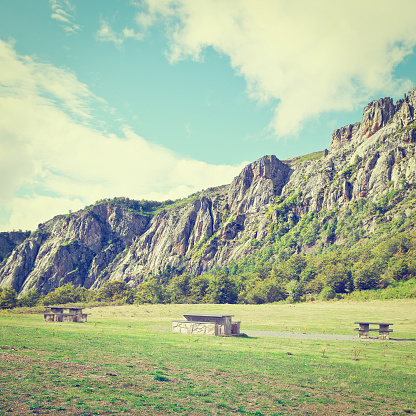 Landscaped Park with Benches for Resting in the Valley of the Cantabrian Mountains in Spain, Retro Effect