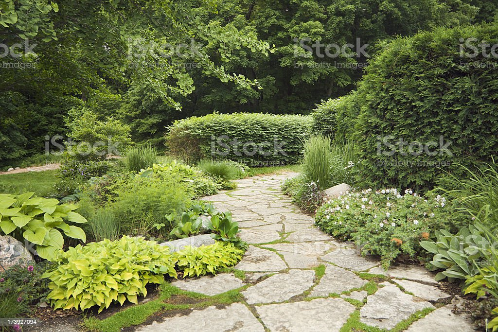 Landscaped Patio with Formal, Ornamental Gardens, Flowers, and Stone Path stock photo