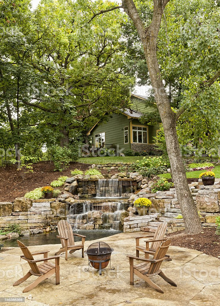 Landscaped Patio with Waterfall stock photo