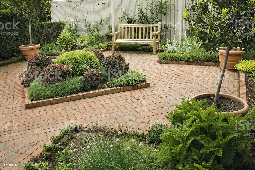 Landscaped Small Back Yard Urban Patio Garden with Furniture, Flowers stock photo