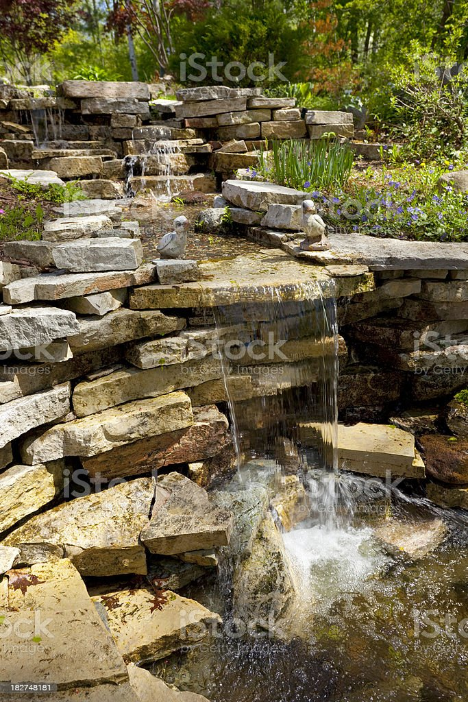 Landscaped Terraced Back Yard Rock Garden With Waterfall stock photo