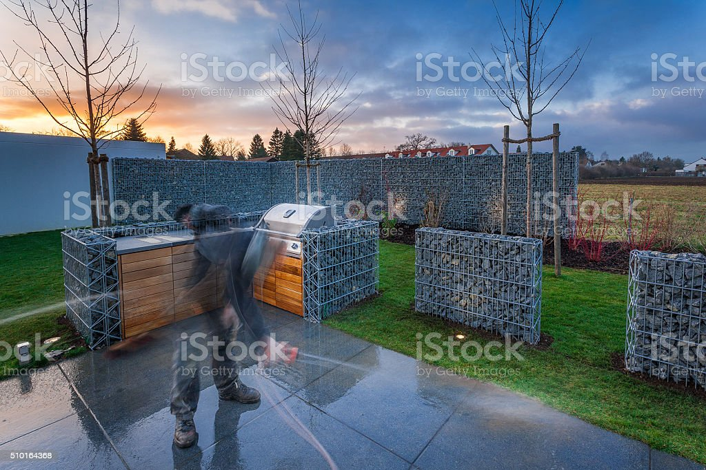 Landscapers cleaning Private Garden stock photo
