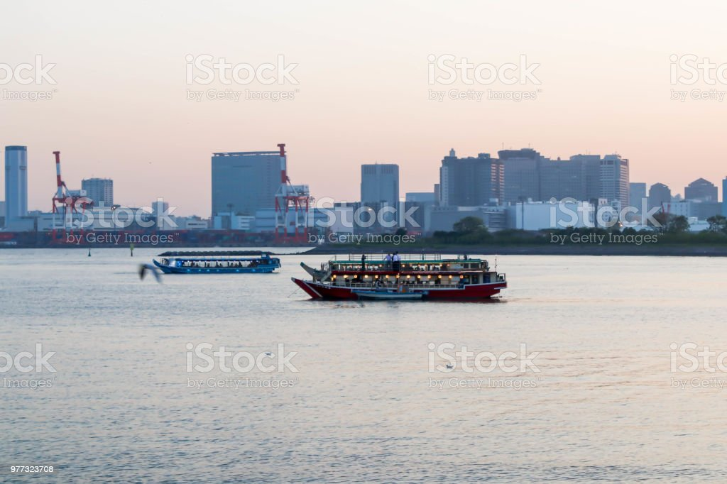 Landscapes of sunset and three boats at sumida river sunset viewpoint ,tokyo stock photo
