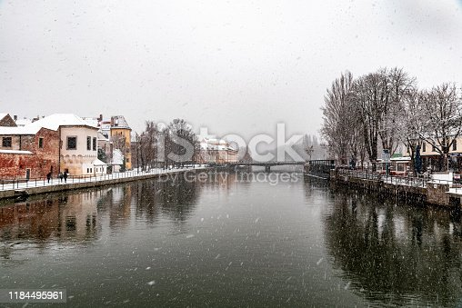Landshut in winter with snowflakes and reflection