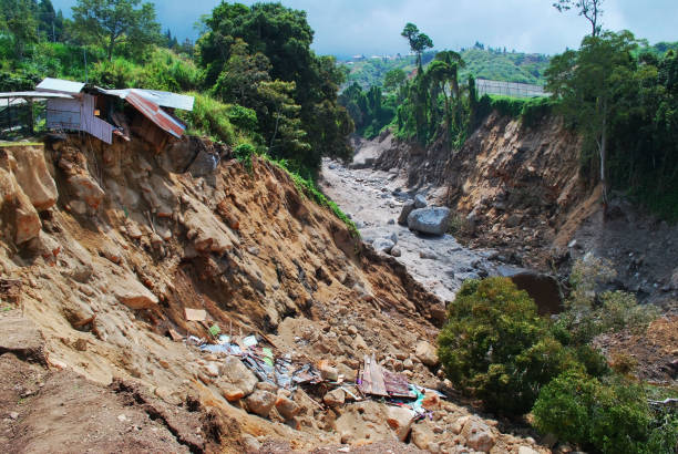 Landslide erosion caused of earthquake and heavy rain. Landslide and soil erosion, a down slope movement of mass of earth, debris or rock down a slope due to the action of external forces such as rainfall, earthquakes, anthropocentric activities etc. eroded stock pictures, royalty-free photos & images