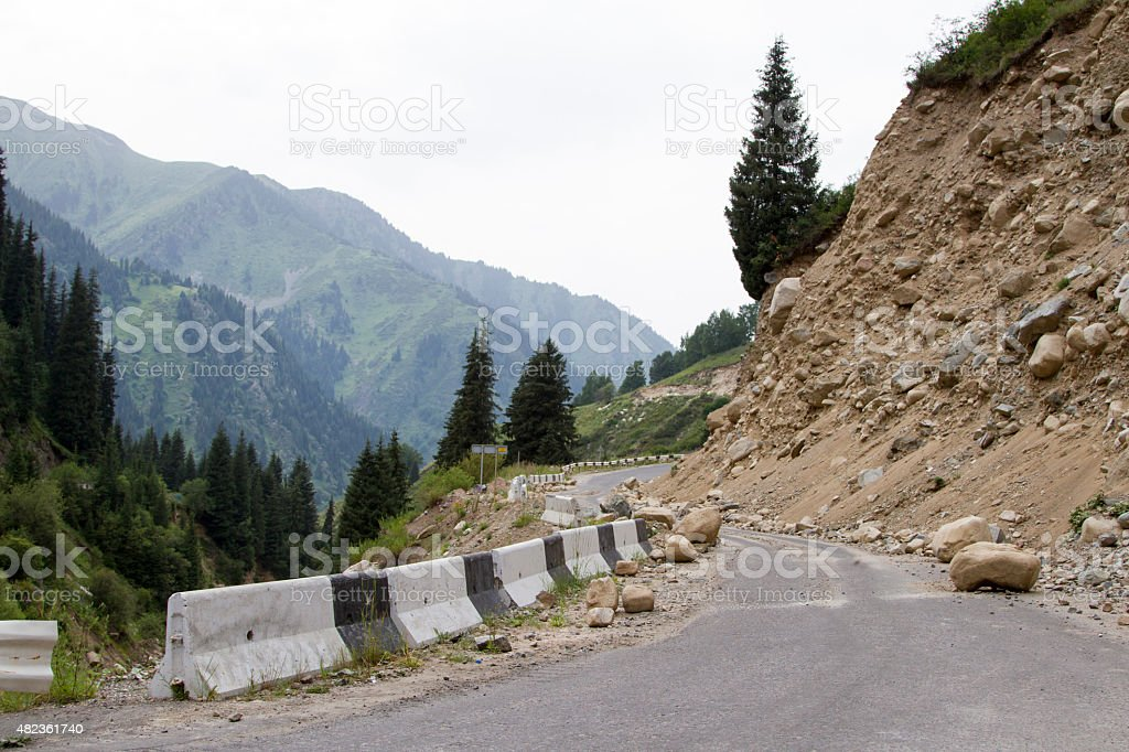 landslide on the mountain road stock photo