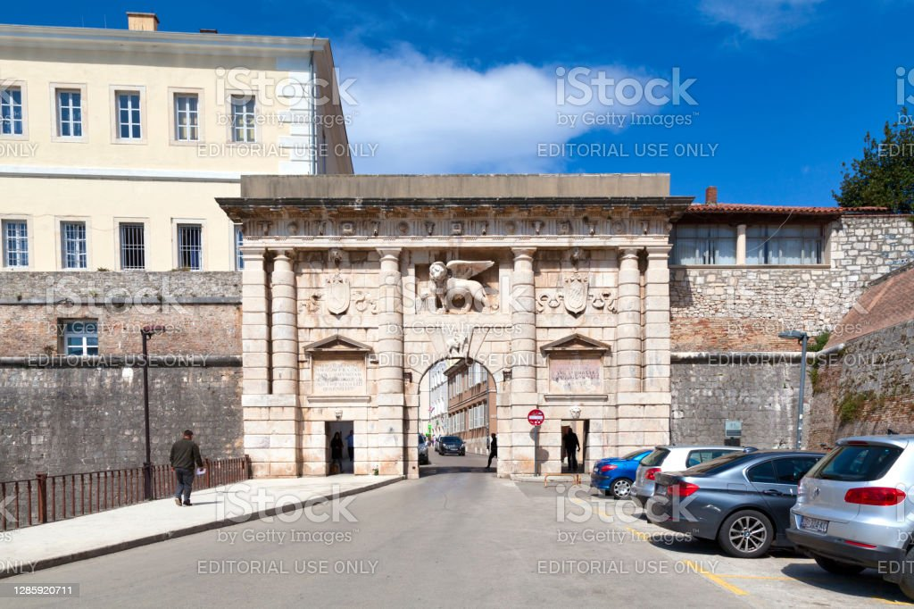 "Landward Gate in Zadar Zadar, Croatia - April 15 2019: The ""Kopnena vrata"" (Landward Gate) with the Lion of Saint Mark, a symbol of the Republic of Venice, above it Architecture Stock Photo"