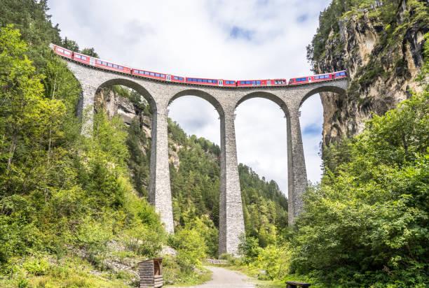 Landwasser Viaduct, Davos, Switzerland Famous viaduct (Landwasser Viaduct) near Filisur and Davos, Switzerland zug stock pictures, royalty-free photos & images