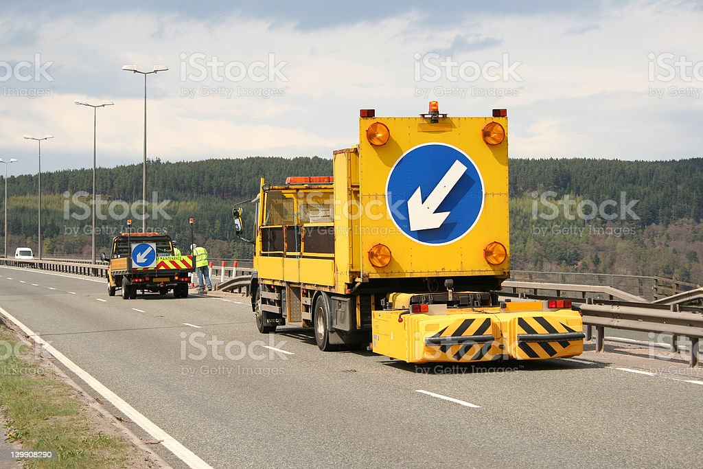 Lane closed vehicle with arrow sign royalty-free stock photo