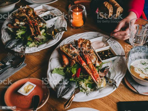 Langoustines on salad with sauces in restaurant in hofn iceland picture id897484142?b=1&k=6&m=897484142&s=612x612&h=i vbaheaaosurk9cdaxlhfjekjrlz1lwb evqje3xs8=