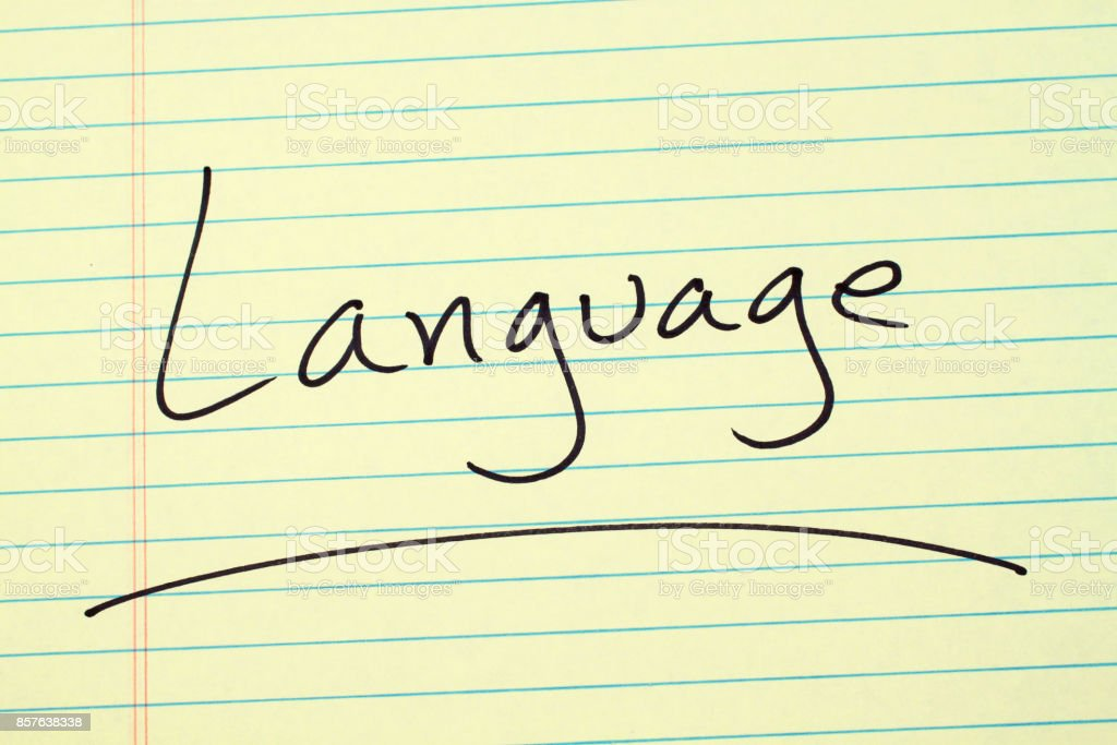 Language On A Yellow Legal Pad stock photo