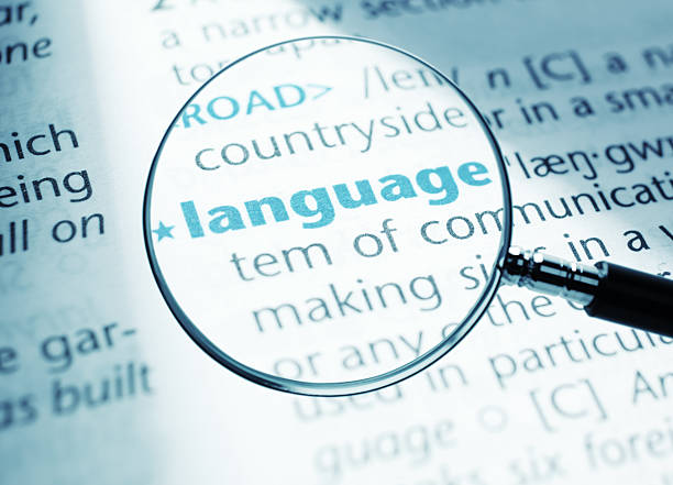 """Language """"Definition of the word - language, close-up shot from a dictionary."""" english language stock pictures, royalty-free photos & images"""
