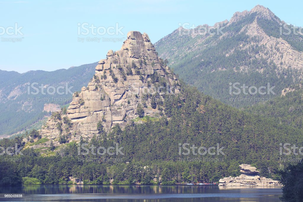 Lanscape of lake at the foot of the mountain royalty-free stock photo