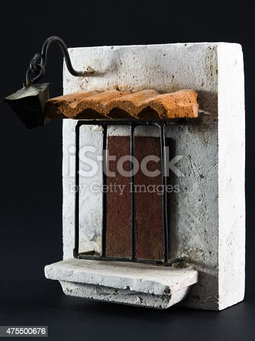istock Lantern above door, pumice-stone souvenir on black background 475500676