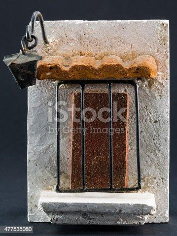 istock Lantern above door, pumice-stone souvenir on black background 477535080