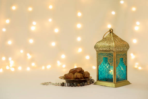 lantern and dates fruits in front of bokeh background - eid stock pictures, royalty-free photos & images