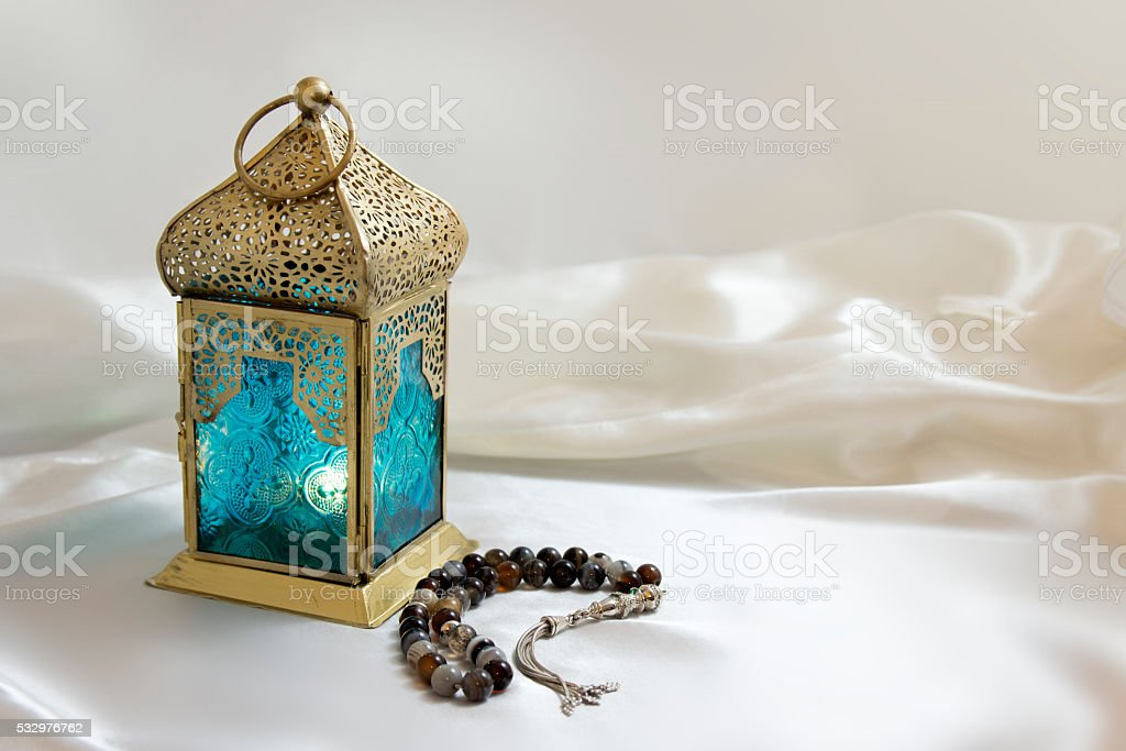Lantern and rosary stock photo
