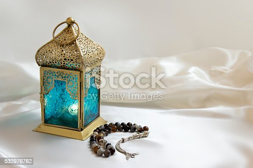istock Lantern and rosary 532976762