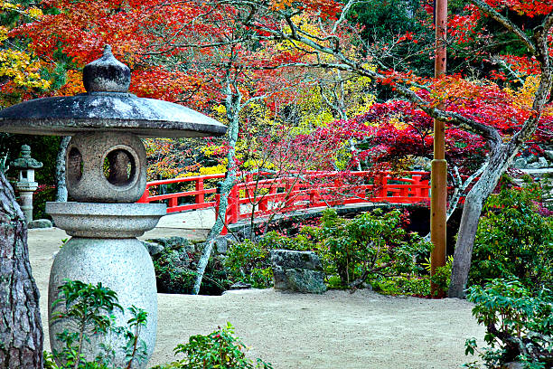 Lantern, Bridge and Autumn Colours in Miyajima Japan Lantern, Bridge and Autumn Colours in Miyajima Japan hiroshima prefecture stock pictures, royalty-free photos & images