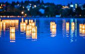istock lantern floating on green lake park for memorial of Hiroshima,Wa,usa 1249806961