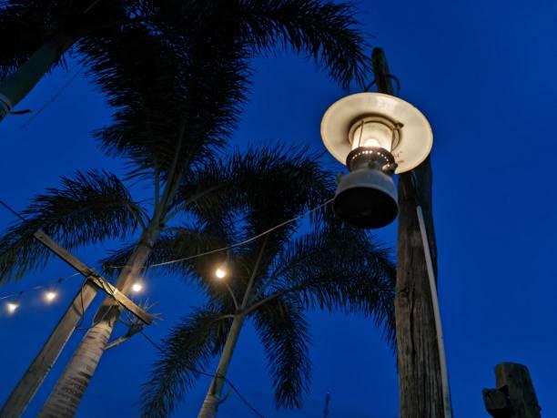 A lantern hanging on a pole stock photo