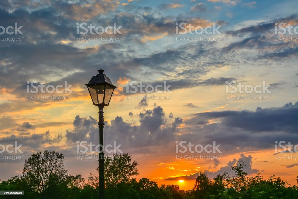 Lantern in retro style on a background of a colorful sunset stock photo